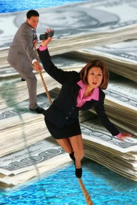 Businesswomen Balancing Over Money