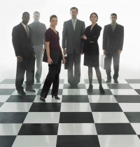 Businesspeople on Chess Board --- Image by © Royalty-Free/Corbis