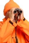 hunter looking through binoculars..