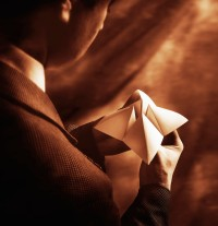 Businessman Playing with Paper Fortuneteller