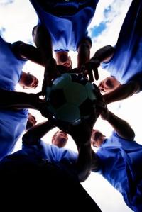 Soccer Team Holding Ball