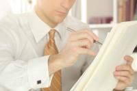 Businessman Marking Document